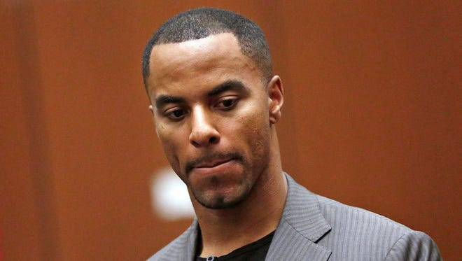 Former NFL player Darren Sharper had 20 Ambien pills in his possession when Los Angeles police arrested him on suspicion of two rapes there in October and January.