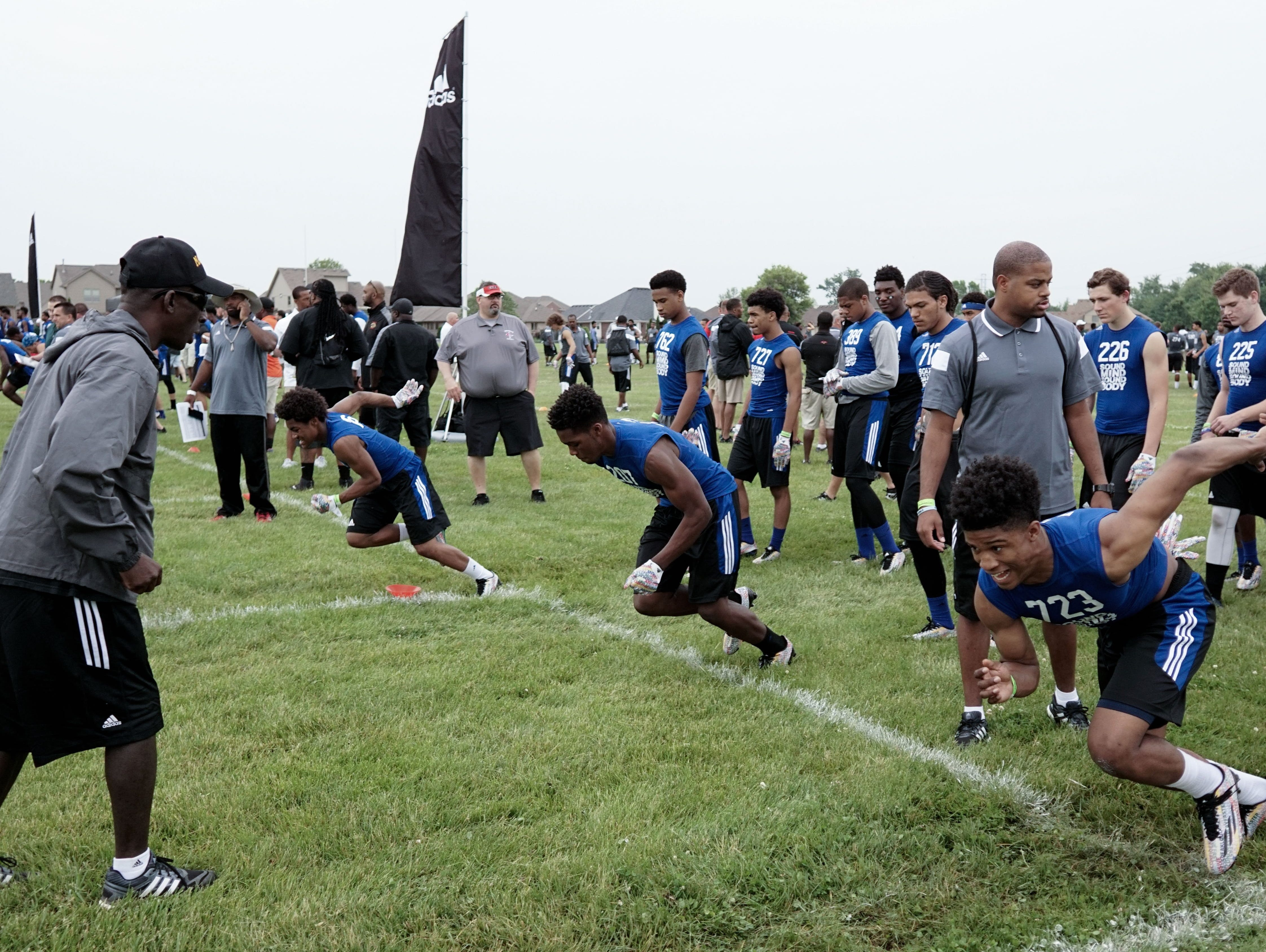 Student athletes run drills with coaches from all over the country during the Sound Mind Sound Body camp on Friday at Macomb Dakota.