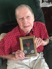 Stewart with the Bronze Star he was awarded with the