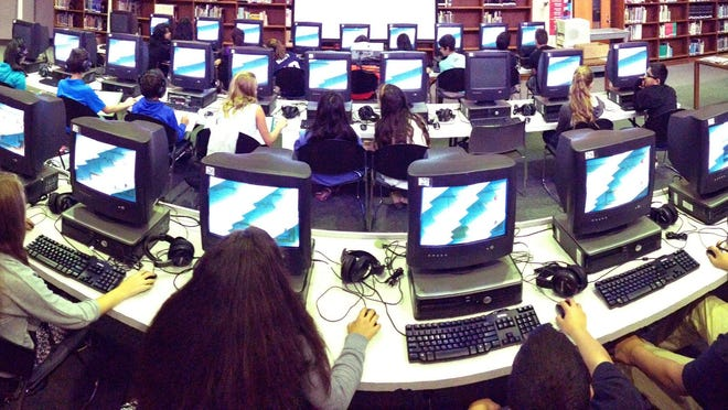 Students at Toms River Intermediate School North use computers to take the Partnership for Assessment of Readiness for College and Careers exams in this Oct. 2 file photo. New Jersey is scuttling the Common Core State Standards the PARCC measures, but retaining the controversial assessments.