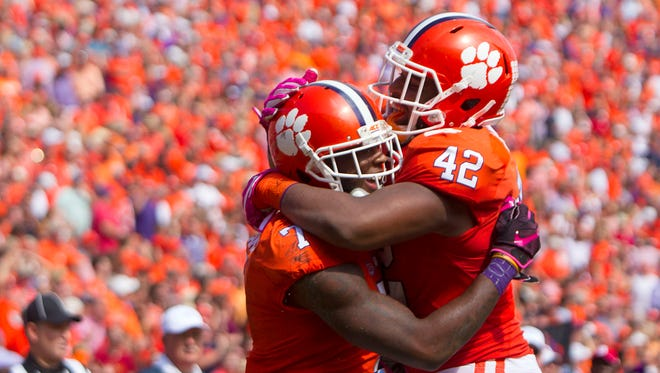 Clemson Tigers wide receiver Mike Williams reacts with defensive lineman Christian Wilkins after scoring a touchdown during the first half against NC State.