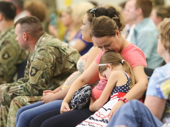 Brittney Myers holds her daughter Kiley Myers, 7, during