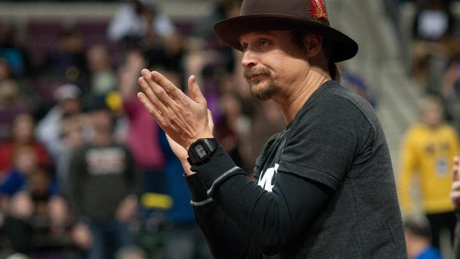 Recording artist Kid Rock in attendance during the game between the Detroit Pistons and the Philadelphia 76ers at The Palace of Auburn Hills in 2014.