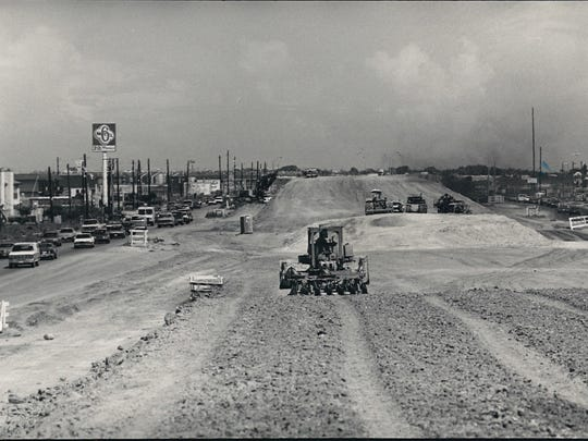 Work continues on South Padre Island Drive (SPID) near the Paul Jones Avenue intersection in August 1987.