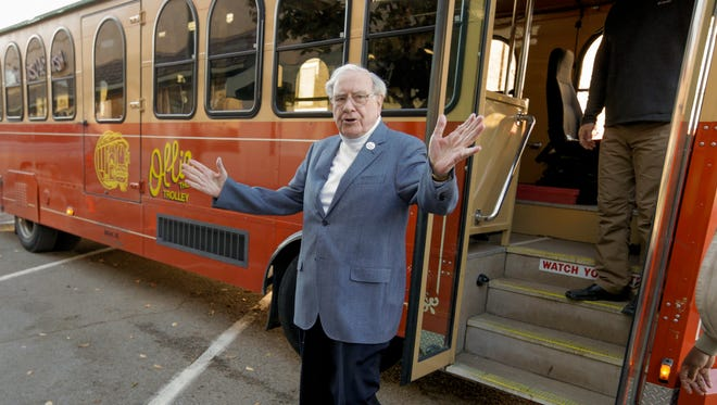 Billionaire investor Warren Buffett arrives in a trolley he rented to take voters to their polling station in Omaha.