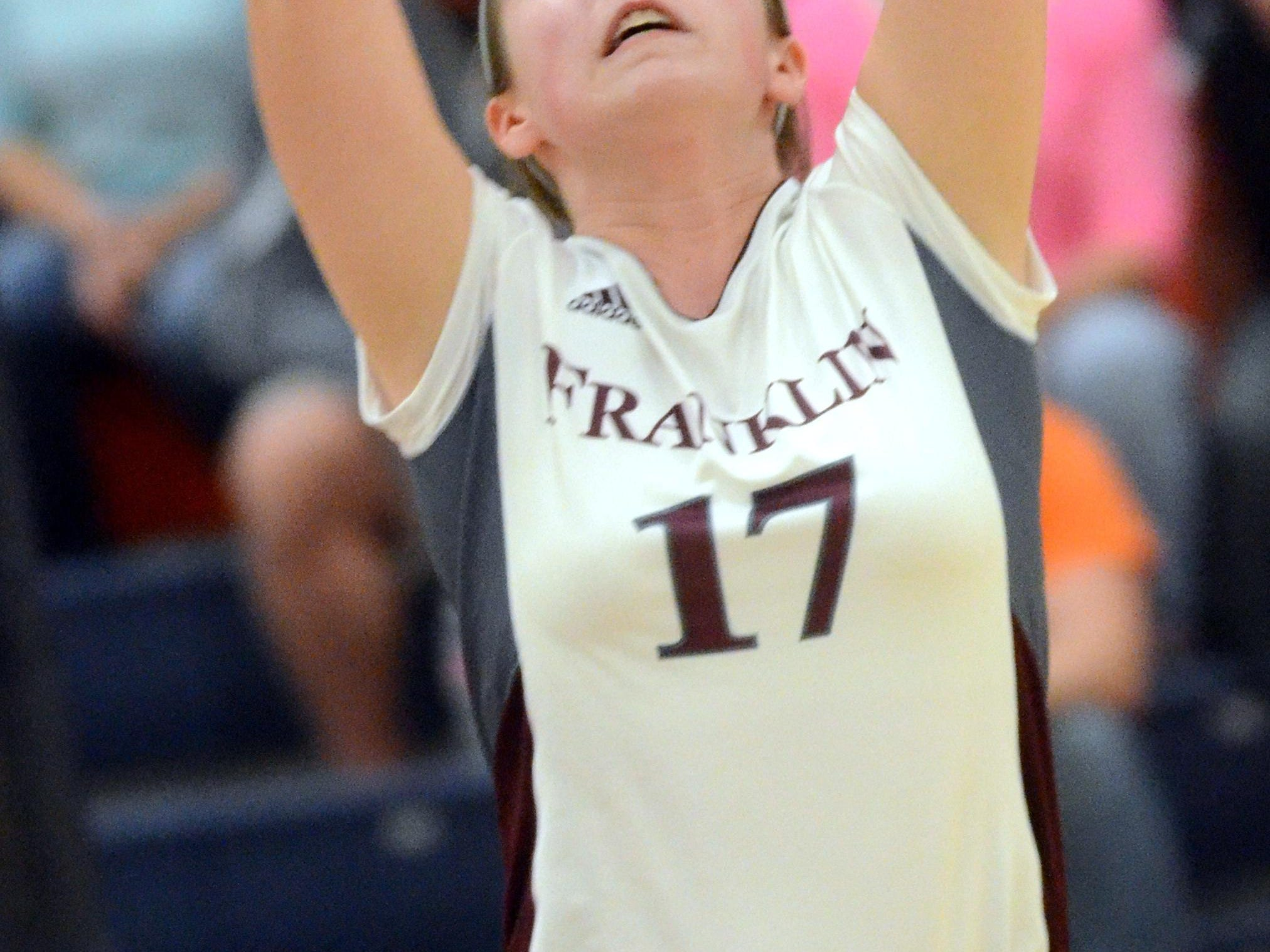 Franklin High junior Breanna Carlton sets a ball during the second game of Thursday's sectional match at Beech.