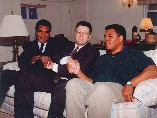 Muhammad Ali, right, sits with Gettysburg native Virgil