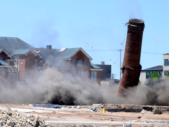 Hamilton Manufacturing Co.'s 233-foot smokestack crumbles