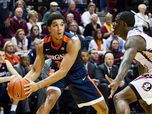 Virginia forward Isaiah Wilkins tries to pass against Florida State guard Dwayne Bacon, Jr. in the second half of an NCAA college basketball game in Tallahassee, Fla., Sunday, Jan. 17, 2016. Florida State defeated Virginia 69-62. (AP Photo/Mark Wallheiser)