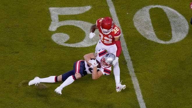 Back in action after spending the first three weeks of the season on injured reserve, Patriots receiver Gunner Olszewski catches a pass in front of Chiefs safety Tyrann Mathieu during the first half of the game Oct. 5 in Kansas City.