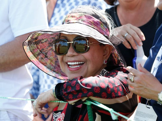 Kultida Woods, Tiger Woods' mother, watches as her son plays on the third hole during the third round of the Honda Classic golf tournament, Saturday, Feb. 24, 2018 in Palm Beach Gardens, Fla. (AP Photo/Wilfredo Lee)