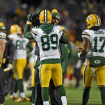 Green Bay Packers receiver Jordy Nelson congratulates James Jones after Jones made a touchdown catch against the Minnesota Vikings in the fourth quarterat TCF Bank Stadium in Minneapolis.