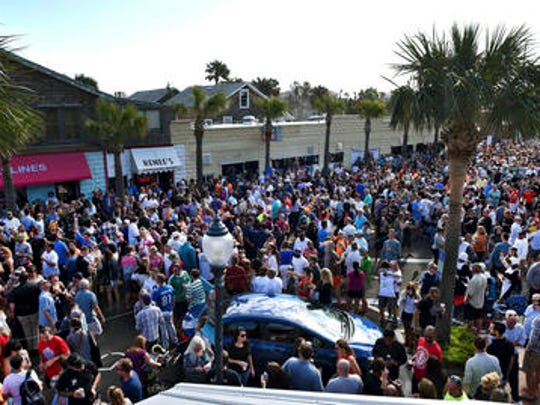 A sea of people gather in front of Pete's Bar and Neptune Beach City Hall during Pete's Thanksgiving Block Party, Thursday, Nov. 24, 2016 in Neptune Beach, Fla.