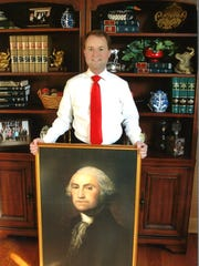 Rutherford County Commissioner Robert Stevens poses with portrait of George Washington presented to him by the Daughters of the American Revolution, Tennessee Chapter in Columbia, Tennessee.