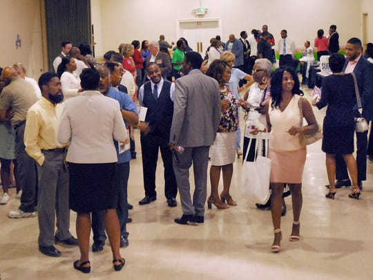 July 9, 2018 - Candidates and voters interact during a recent election meet and greet at Abundant Grace Fellowship. (Stan Carroll/For the Commercial Appeal)