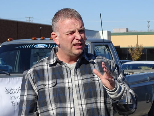 Bucyrus Municipal Court Judge Shane Leuthold speaks about addiction to the crowd gathered at Suburban Lanes for a march against drugs.