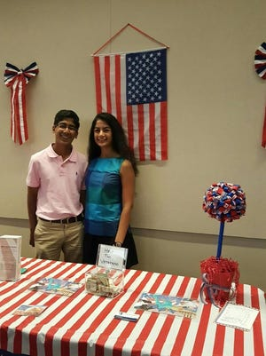 Meera Garg, the founder of Help The Veterans, poses with her brother, Raghav, at a fundraiser for the group.