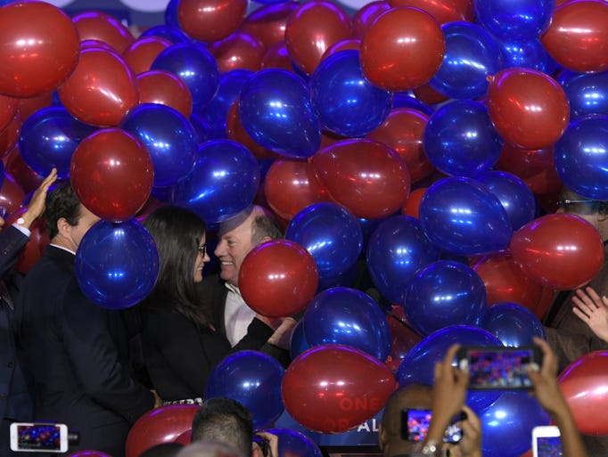 Mayor Mike Duggan is surrounded by balloons as he talks