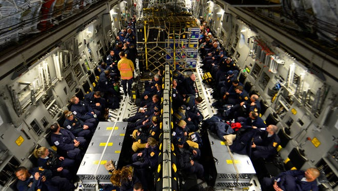 Sixty-nine members of the Fairfax County Urban Search and Rescue Team await takeoff on a U.S. Air Force C-17 Globemaster III at Dover Air Force Base, Del., April 26, 2015. The specially trained team and approximately 70,000 pounds of their supplies are deploying to Nepal to assist with rescue operations after the country was struck by a 7.8-magnitude earthquake. (U.S. Air Force photo/Airman 1st Class William Johnson)
