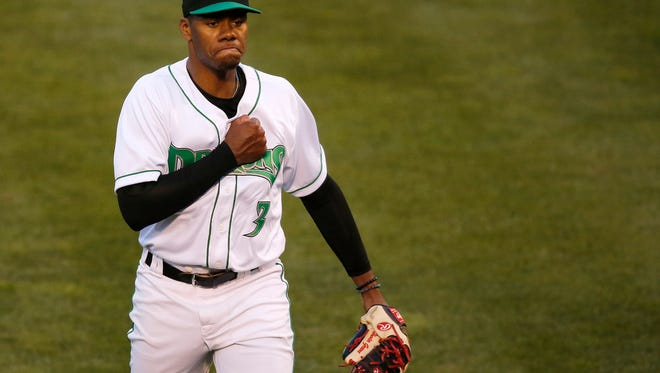 Dayton Dragons pitcher Hunter Greene (3) pounds his chest as he collects his eighth strikeout of the game during the third inning of the MiLB game between the Dayton Dragons and the Lake County Captains at Fifth Third Field in Dayton, Ohio, on Monday, April 9, 2018. Greene, the Cincinnati Reds first-round draft pick, finished his three-inning Dragons debut with eight strikeouts on 50 pitches.