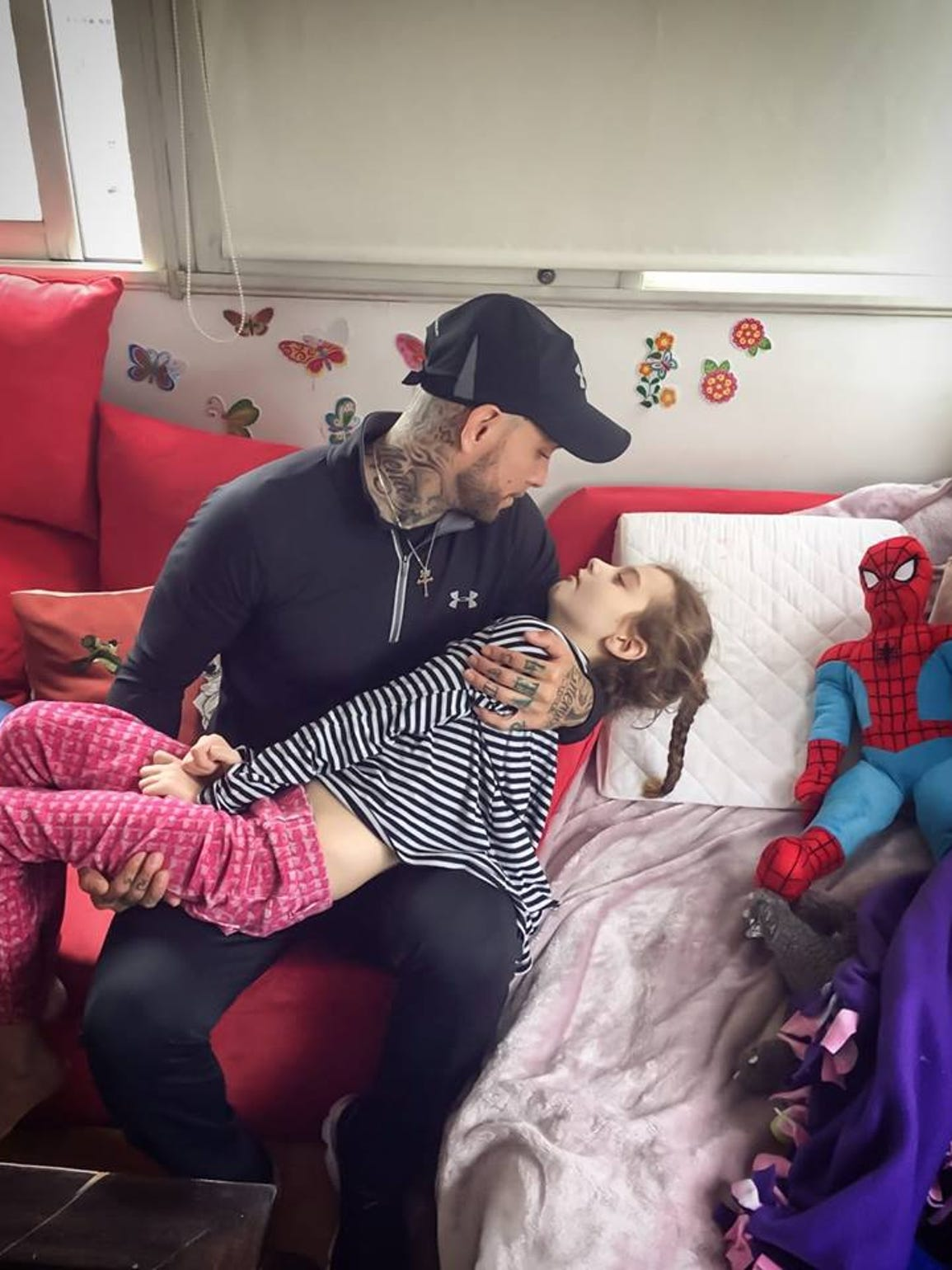 Ricky Mena held Zamora in his arms as she battled terminal cancer.