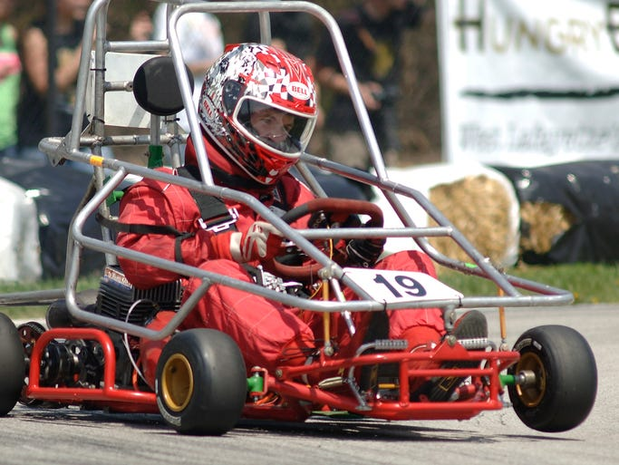 Drivers race, Saturday, April 26, 2014, in the Purdue Grand Prix. Jimmy Simpson started from the pole and led all but 28 of 160 laps in repeating as champion in Saturday's 57th race.