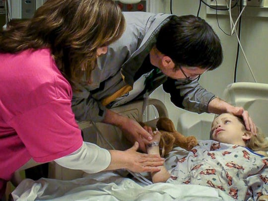 Letitia and Brian Miller comfort their daughter Nicole after the successful transplant surgery in 2013.