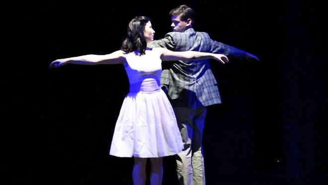 """Erin Tawney and Brant Fife rehearse the scene when Tony and Maria first meet at the dance in """"West Side Story."""""""