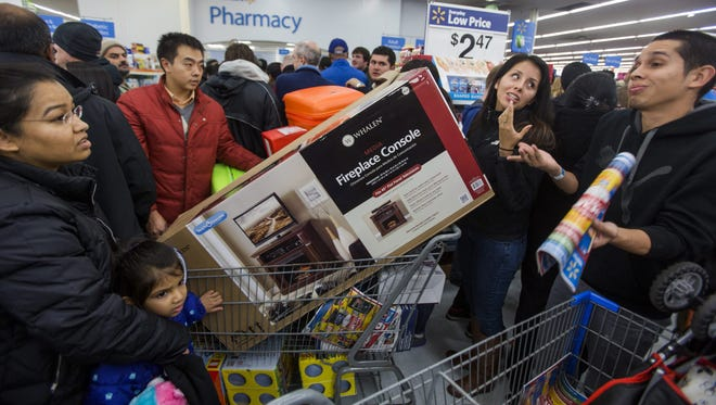 Bargain hunters crowd a Walmart on Thanksgiving Day a year ago. Thanksgiving openings have taken some of the luster off of Black Friday, some shoppers say.