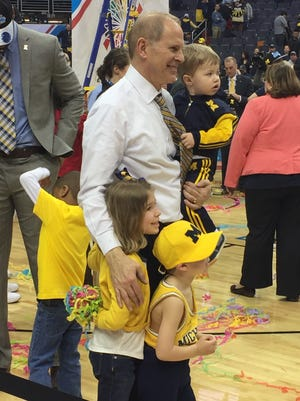 Michigan coach John Beilein with his grandkids after winning the Big Ten title on March 12, 2017.