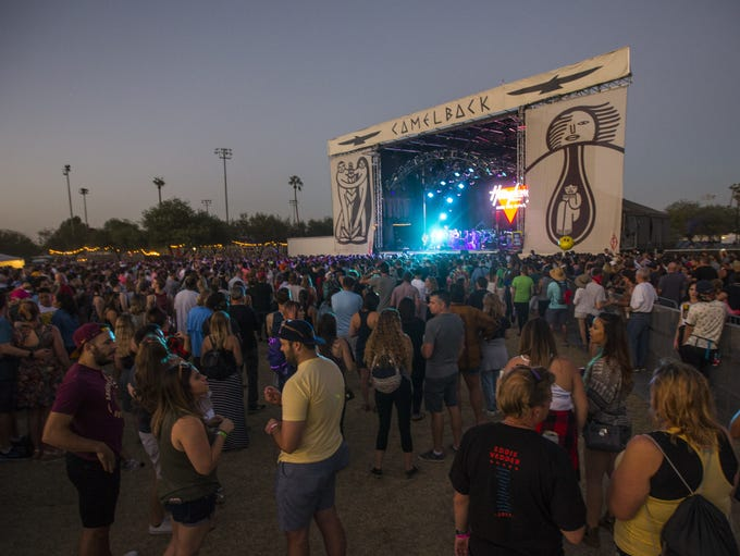 People listen to music at the Camelback stage at Lost