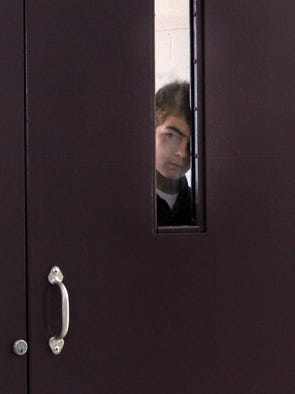Paul Henry Gingerich looks from his locked cell on his housing unit at the Pendleton Juvenile Correctional Facility, Monday, July 25, 2011.  Nearly three years after he became perhaps the youngest Hoosier ever sentenced to prison as an adult, Paul Henry Gingerich – given a second chance in the courts – has agreed to a plea deal that could set him free when he turns 18.