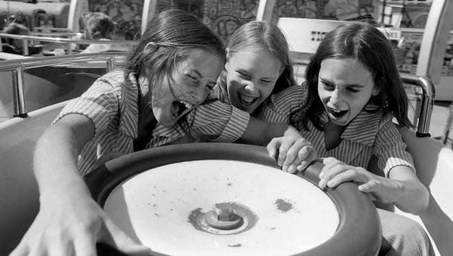 "The fastest rides always seem to be the most fun at the annual Tennessee State Fair. That's what these young fairgoers, Kim Gomer, left, 10, Jennifer Duncan, 11, and Stacy Casady, 10, think aboard the ""Tip Top"" on the midway Sept. 21, 1976."