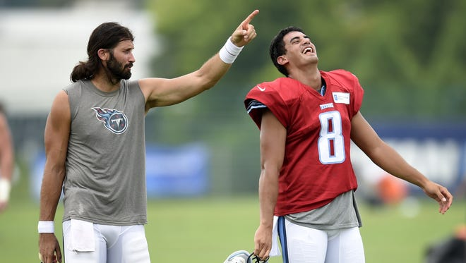 Titans quarterbacks Charlie Whitehurst, left, and Marcus Mariota share a laugh after practice on Aug. 5, 2015.