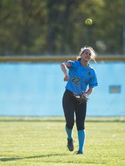 Cape's Kira Vitella tosses the ball around before the inning resumes in a game against Indian River April 29 in Lewes.