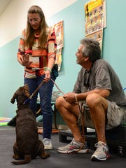 Bayside Dog Training Center Instructor Lenore Bennett works with Frank Favazza and Chance on Wednesday, Oct. 21, 2016.