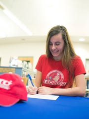 Decatur's Blair Yesko signs with Sacred Heart University's lacrosse team at a signing ceremony Tuesday, Nov. 25 in Berlin.