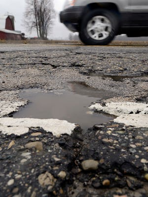 Canton officials are trying to secure more state dollars for townships to fix roads.