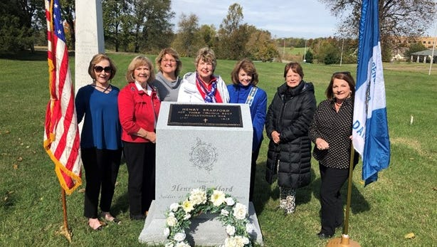 Members of the French Lick Chapter of the DAR pose with the new monument at Revolutionary War soldier Henry Bradford's grave site.  From left to right: Hilda Nason, Nancy Parker, Carolyn Gregory, Sue Ellen Watts, Jane Reynolds, Lockey Rodden, and Mary Kathryn Wise.