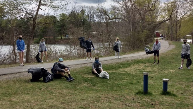 Wellesley High School sailing team members clean up at Morses Pond Front: Left to right: Jordan Feinzig, Will Kelleher. Back: L to R: Hannah Cronin, Ella Kilgore, Alex Haidar, Lily Harmon, Cole Bender,and Tyler Cronin.