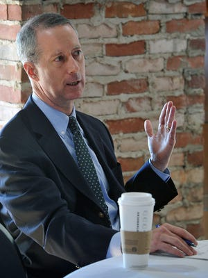 U.S. Congressman Mac Thornberry speaks during meeting with local business leaders touching on the economy, small business and regulations. The meeting was held at Harvest Drug and Gift.