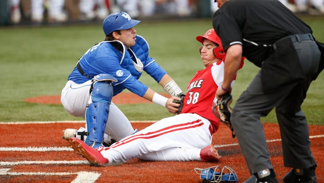 Kentucky Wildcats catcher Troy Squires tags out Louisville Cardinals outfielder Brendan McKay at home during the game against the Louisville Cardinals at Cliff Hagan Stadium in Lexington, Kentucky on Tuesday, April 18, 2017. Michael Reaves/Special to The Courier Journal