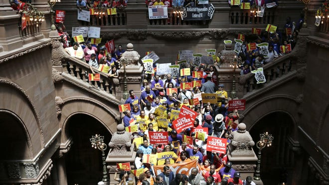 People rally for an increase in the minimum wage June 17 on the Great Western Staircase at the Capitol in Albany.