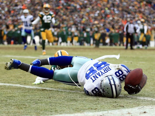 Dallas Cowboys wide receiver Dez Bryant (88) is unable to catch a pass against Green Bay Packers cornerback Sam Shields (37) in the fourth quarter in the 2014 NFC Divisional playoff football game at Lambeau Field.