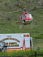 A helicopter takes off from the Hewlett Gulch Trailhead June 4, 2014, with a rafter who drowned while on a private trip on the Poudre River.