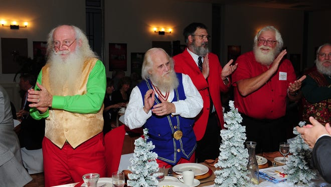 Jolly Santa Clauses, Jim Finn of Winrest, Texas, Norman Gerring of Lincoln Park, John Masserant of Trenton and Richard Knapp of Ravenna celebrate at the the annual Saint Nicholas Awards Gala Wednesday evening in Livonia.