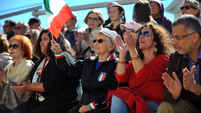 Rosemarie Pindale, of Vineland, waves an Italian flag during Vineland's Columbus Day celebration Monday, Oct. 10, 2016.