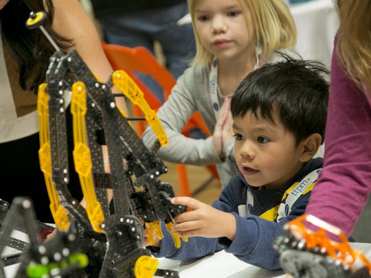Kenzie Nakamoto, 4, plays with toys from Hexbug at the TTPM Holiday Showcase in New York. The U.S. toy industry is expected to have its strongest year in over a decade.