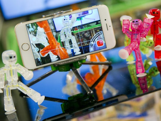 StikBot figures can be used to make movies that are recorded and displayed on an iPhone using the company's StikBot Studio app.