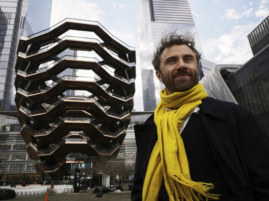 """British designer Thomas Heatherwick poses in front of """"Vessel"""" before it opens to the public at Hudson Yards, Friday, March 15, 2019, in New York."""